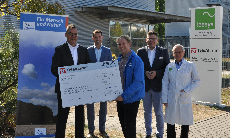 TeleAlarm overhandigt donatie aan NABU – LV Sachsen